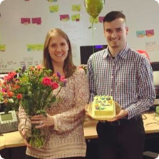 Two recruiters hold work anniversary gifts