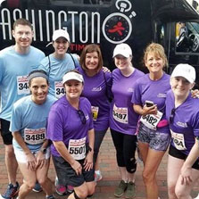 Eight recruiters smiling at a charity run
